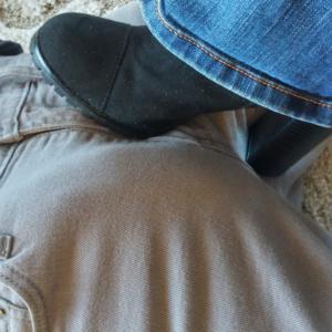 woman's high heel boot stepping on man's crotch