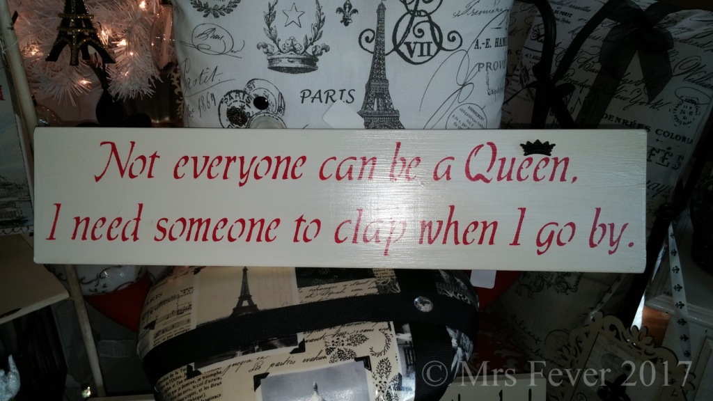 "painted sign that says ""Not everyone can be a Queen. I need someone to clap when I go by."""