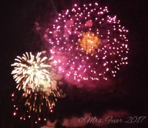 side-by-side colorful fireworks exploding