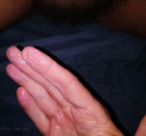 man's hand, wet from finger-fucking
