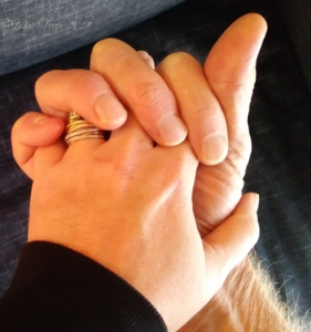 man's and woman's hands entwined