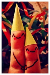 two fingers in party hats
