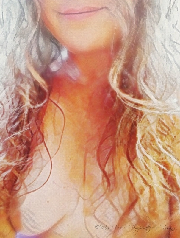 nude woman with long curly hair, smiling